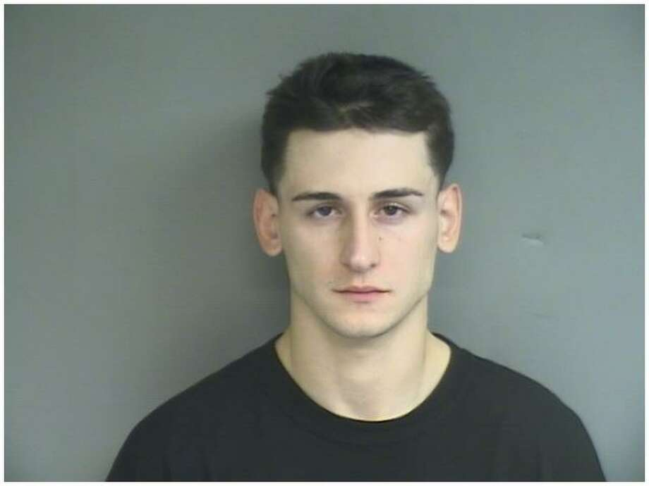 Mikel  Mikey  Gjuraj, 22, of 56 Fox Glen Dr., Stamford, Conn., was charged by Stamford police Nov. 17, 2012 with home invasion, four counts of first-degree unlawful restraint, first-degree robbery, second-degree assault, risk of injury to a minor and conspiracy. Photo: Stamford Police Department