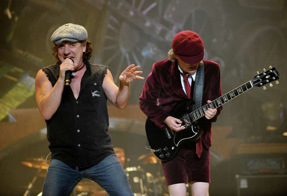 "FILE -  In this Nov. 12, 2008 file photo, AC/DC lead singer Brian Johnson, left, and Angus Young perform on the Black Ice tour at Madison Square Garden in New York. Columbia Records and Apple announced Monday, Nov. 19, 2012, that the classic rock band's music will be available at the iTunes Store worldwide. Sixteen albums will be released, including ""High Voltage"" and ""Back in Black."" (AP Photo/Jeff Zelevansky, file) Photo: Jeff Zelevansky"