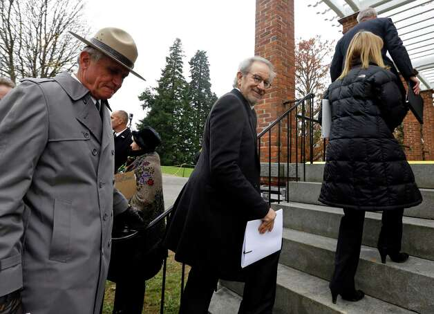 Director Steven Spielberg, center, arrives at a ceremony to mark the 149th anniversary of President Abraham Lincoln's delivery of the Gettysburg Address at Soldier's National Cemetery in Gettysburg, Pa., Monday, Nov. 19, 2012. Walking behind Spielberg is Bob Kirby, Superintendent of Gettysburg National Military Park. Spielberg and historian Doris Kearns Goodwin delivered remarks and participated in a wreath-laying ceremony. (AP Photo/Patrick Semansky) Photo: Patrick Semansky