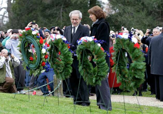 Director Steven Spielberg, left, and Janet Morgan Riggs, President of Gettysburg College, pause after laying a memorial wreath during a ceremony to mark the 149th anniversary of President Abraham Lincoln's delivery of the Gettysburg Address at Soldier's National Cemetery in Gettysburg, Pa., Monday, Nov. 19, 2012. (AP Photo/Patrick Semansky) Photo: Patrick Semansky
