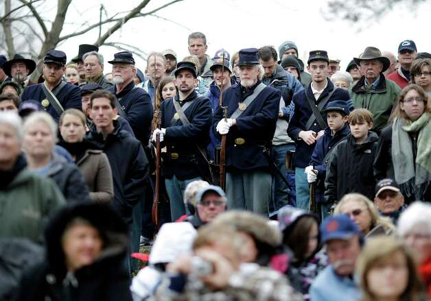 Civil War re-enactors depicting Union soldiers stand amongst spectators during a ceremony to mark the 149th anniversary of President Abraham Lincoln's delivery of the Gettysburg Address at Soldier's National Cemetery in Gettysburg, Pa., Monday, Nov. 19, 2012. Director Steven Spielberg and historian Doris Kearns Goodwin were also on hand to deliver remarks and participate in a wreath-laying ceremony. (AP Photo/Patrick Semansky) Photo: Patrick Semansky