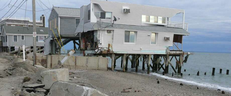 Property owners and town officials alike are struggling over what to do with homes damaged by Superstorm Sandy. Fairfield, CT 11/19/12 Photo: Genevieve Reilly / Fairfield Citizen