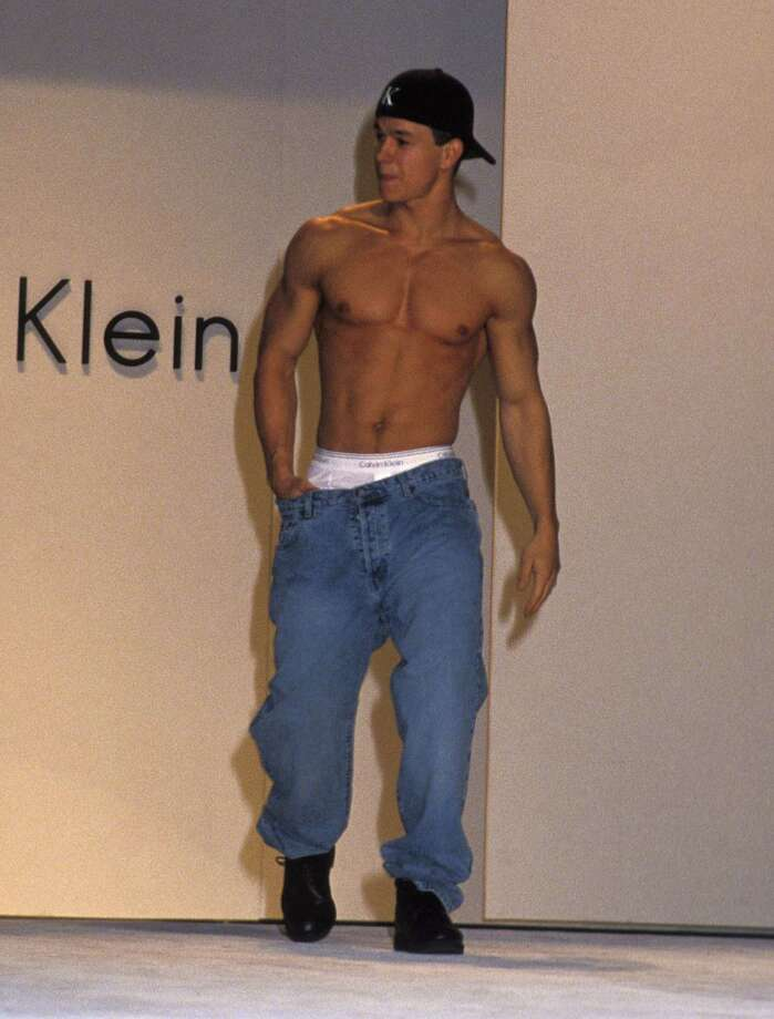 "Back when Mark Wahlberg was rapper ""Marky Mark,"" the public got its first view of his famous abs when he appeared in a giant Calvin Klein underwear billboard in Times Square in 1992. He's pictured in 1993 on a fashion runway in Hollywood.  Photo: Ron Galella, Ltd., WireImage / 1993 Ron Galella, Ltd."