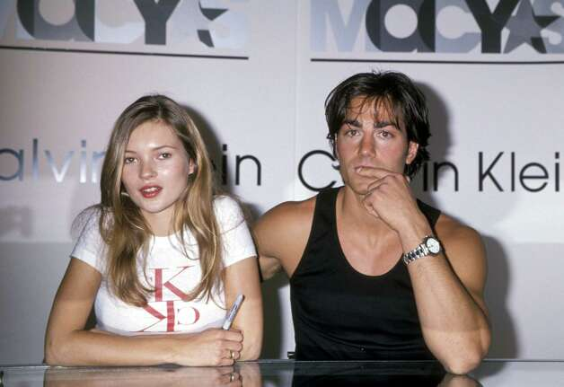 Kate Moss in 1994, with Michael Bergin at a Calvin Klein Shop appearance at Macy's in New York City.  Photo: Jim Smeal, WireImage / Ron Galella Collection
