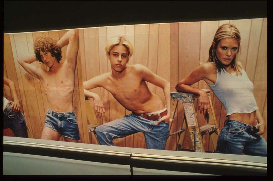 Calvin Klein ads in the '90s ignited controversy over use of child-like models in sexualized poses in which some said looked like child porn. This ad appeared on buses in New York City in 1995.  Photo: Evan Agostini, Getty Images / Getty Images North America