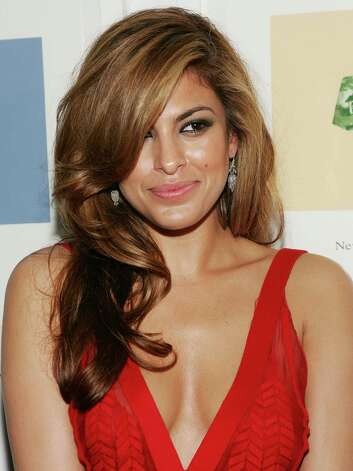 More recently, actress Eva Mendes shed her clothes for a series of sexy Calvin Klein underwear, jeans and perfume ads. Photo: Evan Agostini, Getty Images / 2006 Getty Images