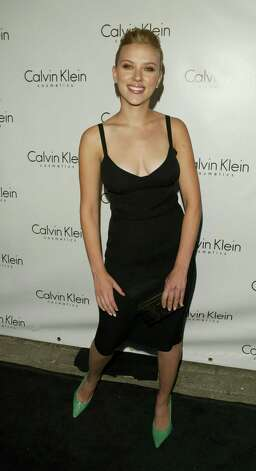"It was hard to find photos of Scarlett Johansson standing up straight at the 2004 launch party for Calvin Klein's ""Eternity"" fragrance. See for yourself.  Photo: Peter Kramer, Getty Images / 2004 Getty Images"