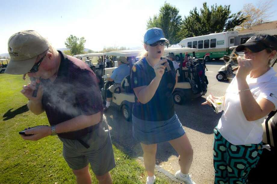 Diane and Dina Kupfer and myself fire up mid-day stogies to power through the rest of the afternoon. (Ted Johnson / Courtesy)