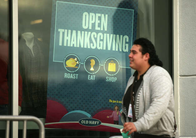 A sign in the window of Old Navy in Milford advertises their Thanksgiving Day opening. Photo: Brian A. Pounds / Connecticut Post