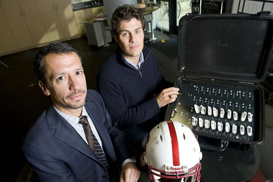 Dr. Daniel Garza (left) and David Camarillo,  assistant professors at Stanford University, are teaming up with the school's football team to study what happens to the head and neck when a head injury occurs. Photo: Susana Bates, Special To The Chronicle