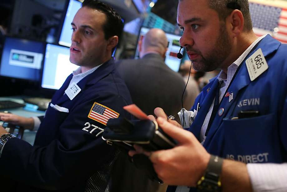 """Traders work on the floor of the New York Stock Exchange, which """"shook its post-election slump."""" Photo: Spencer Platt, Getty Images"""