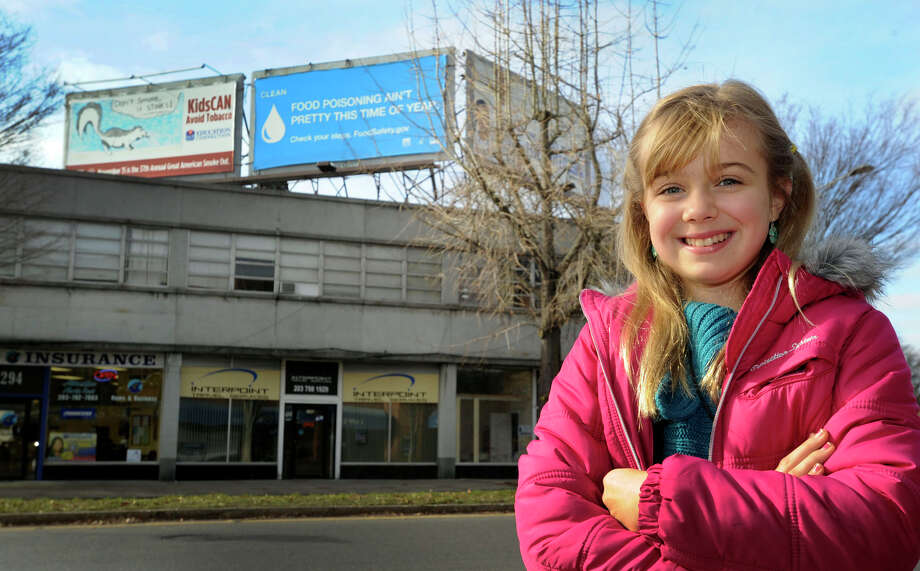Joli Maxwell, 10, of Danbury, designed the ant-smoking billboard that can be see on Main Street in Danbury, Monday, Nov. 20, 2012. Photo: Carol Kaliff / The News-Times