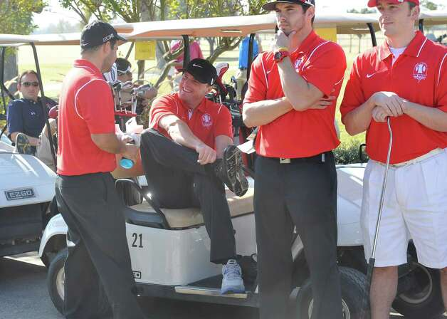 Jay Bruce, center, joins his team and changes into his golf shoes.  The Third Annual Jay Bruce Golf Benefit was held Monday morning, November 19, 2012, at Bayou Din Golf Club. Proceeds benefit The Arc of Greater Beaumont and the Life Skills Department at West Brook High School.  Dave Ryan/The Enterprise Photo: Dave Ryan