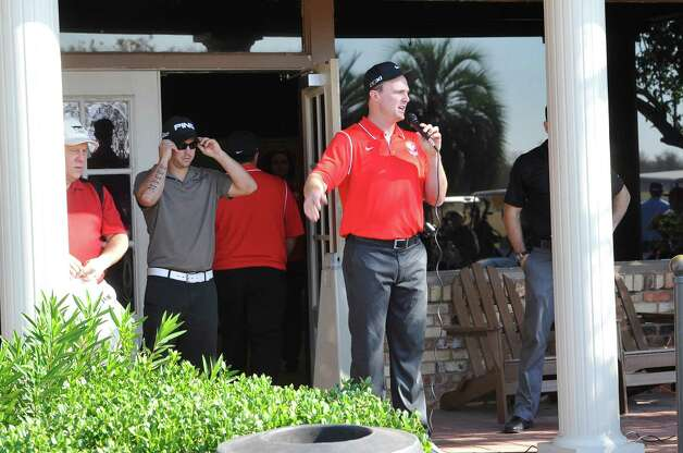 Jay Bruce, center, welcomes everyone to his golf tournament before all the players headed for their starting hole. The Third Annual Jay Bruce Golf Benefit was held Monday morning, November 19, 2012, at Bayou Din Golf Club. Proceeds benefit The Arc of Greater Beaumont and the Life Skills Department at West Brook High School.  Dave Ryan/The Enterprise Photo: Dave Ryan