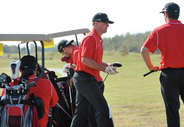 Jay Bruce, center, grabs his driver to tee off on number five. The Third Annual Jay Bruce Golf Benefit was held Monday morning, November 19, 2012, at Bayou Din Golf Club. Proceeds benefit The Arc of Greater Beaumont and the Life Skills Department at West Brook High School.  Dave Ryan/The Enterprise Photo: Dave Ryan