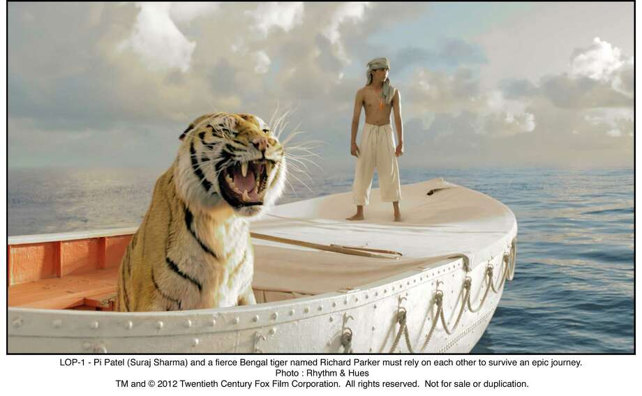 LOP-1 - Pi Patel (Suraj Sharma) and a fierce Bengal tiger named Richard Parker must rely on each other to survive an epic journey. Photo: Photo : Rhythm & Hues