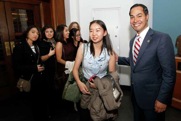 "Mayor of San Antonio, Julian Castro, right, poses with a student from San Antonio after his speech to the students on ""US Leadership in the 21st Century"" at the London School of Economics and Political Science in London, Monday, Nov. 19, 2012. Photo: Sang Tan, AP / AP"
