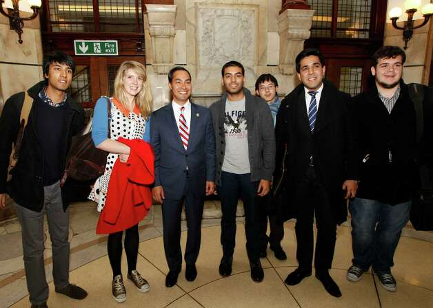 "Mayor of San Antonio, Julian Castro, third left, poses with students after his speech to the students on ""US Leadership in the 21st Century"" at the London School of Economics and Political Science in London, Monday, Nov. 19, 2012. Photo: Sang Tan, AP / AP"