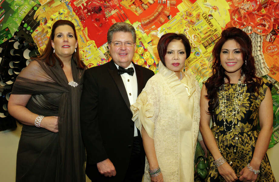 Images of Power and Beauty: Celebrating the Romo Collection:  Sponsor Molly Calvert (from left), Nini Jewels director Cliff Bueche,  jewelry designer Nini Hale and daughter Bebe Hale gather during the gala  at the McNay Art Museum.  Photo: Leland A. Outz, For The Express-News / SAN ANTONIO EXPRESS-NEWS