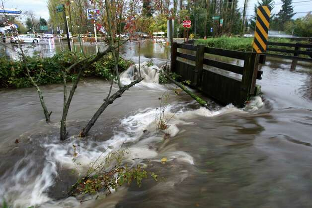 Lyon Creek flows around a bridge in Lake Forest Park during a significant rainfall on Monday, November 19, 2012. Photo: JOSHUA TRUJILLO / SEATTLEPI.COM