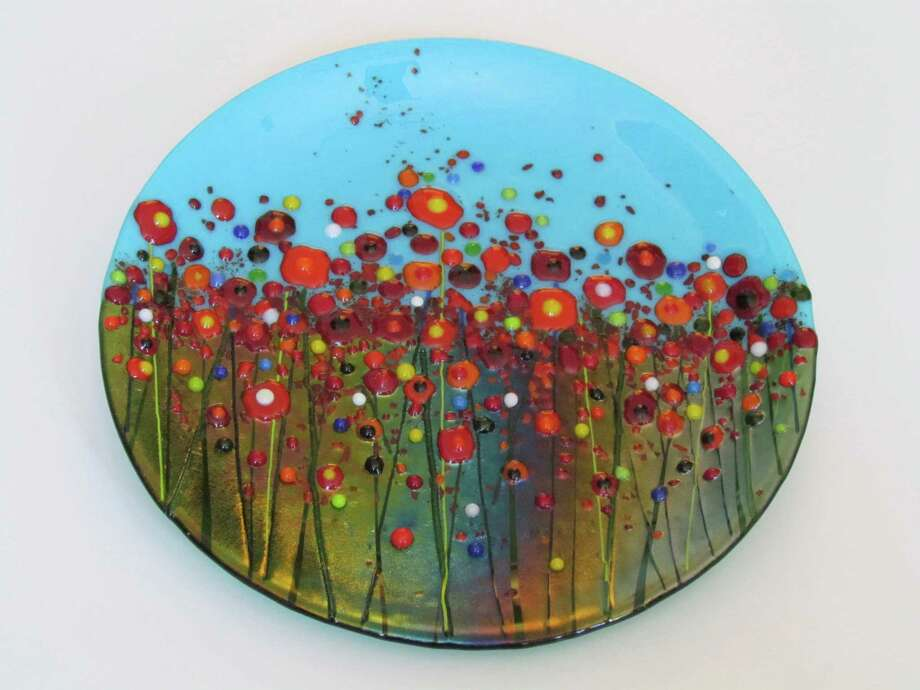 A local Artisans Show opens at the New Milford Railroad Station in New Milford this weekend, running Friday, Nov. 23 through Sunday, Nov. 25, from 10-5 p.m. Pieces such as this glass artwork by Linda Banks, of  Banks Art Studio in New Preston, will be among the many offerings. Photo: Contributed Photo