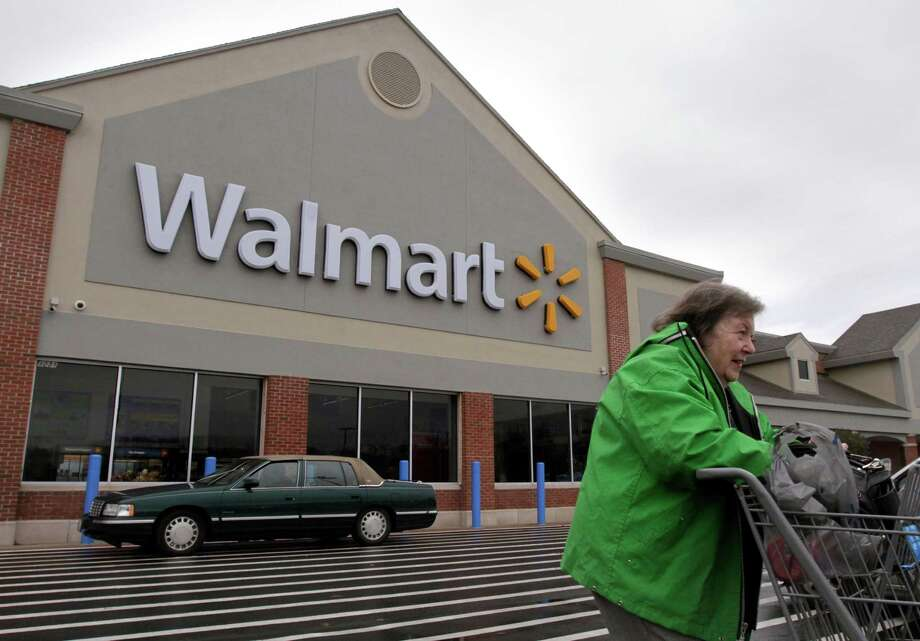 The group OUR Walmart is supporting a Friday walkout at hundreds of stores. The national Labor Relations Board promises a quick legal ruling on the plan. Photo: Steven Senne, STF / AP