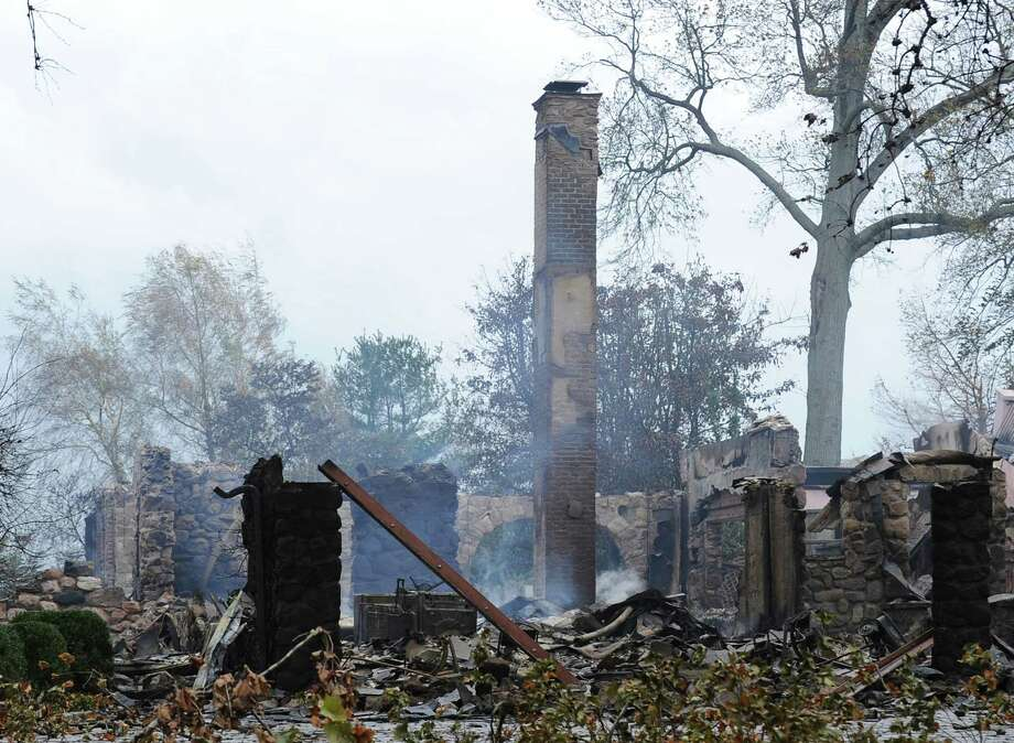The aftermath of a house fire at 44 Binney Lane in Old Greenwich, on Oct. 30, 2012. Greenwich fire officials met Monday, Nov. 19, 2012 with representatives of Aquarion Water Co. to try to determine the reliability of the utility's infrastructure. Photo: Bob Luckey / Greenwich Time