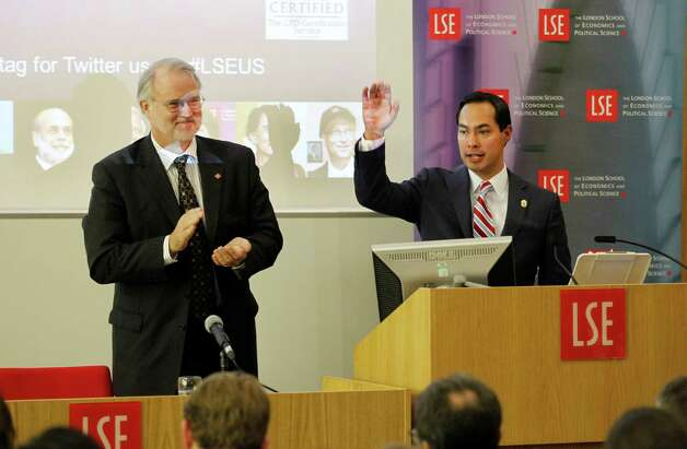 "Mayor of San Antonio, Julian Castro, right, reacts to the applauds from Director of LSE Professor Craig Calhoun, left, and the students at the end of his speech to the students on ""US Leadership in the 21st Century"" at the London School of Economics and Political Science in London, Monday, Nov. 19, 2012. Photo: Sang Tan, AP / AP"