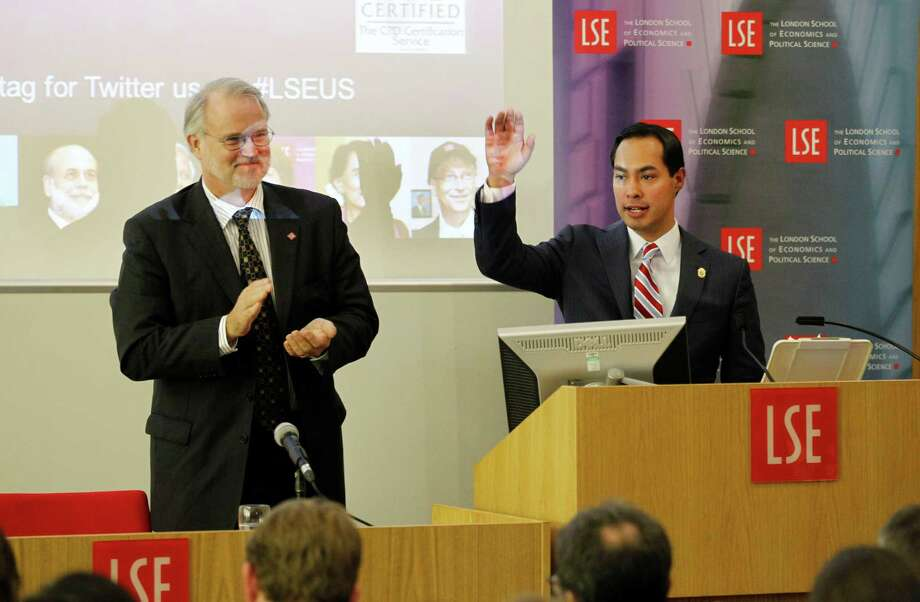 "Special for San Antonio Express-News. Mayor of San Antonio, Julian Castro, right, reacts to the applauds from Director of LSE Professor Craig Calhoun, left, and the students at the end of his speech to the students on ""US Leadership in the 21st Century"" at the London School of Economics and Political Science in London, Monday, Nov. 19, 2012. Photo: Sang Tan, AP / AP"