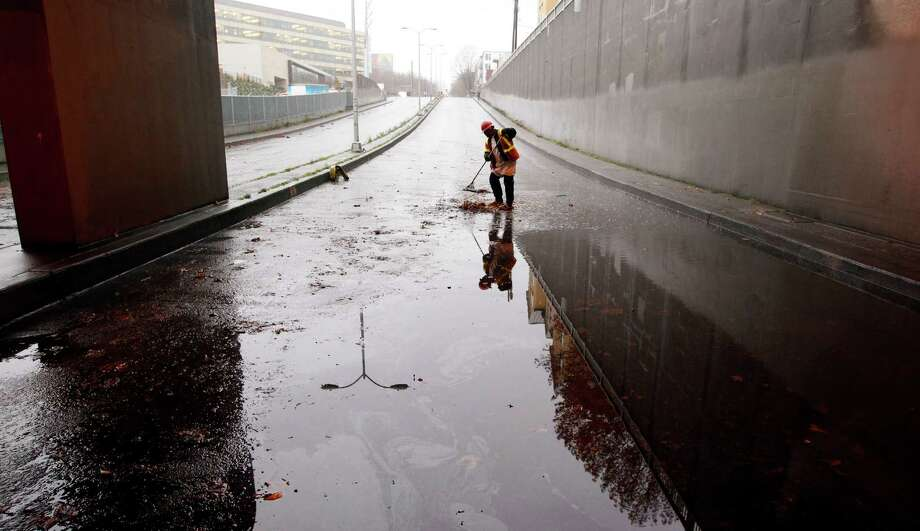 In an effort to help you think less positively about your future and so live a longer and healthier life, here is a photo showing the gloom and doom of a Seattle winter. Photo: Elaine Thompson / Associated Press