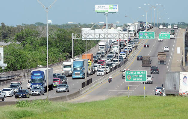 East bound traffic on Interstate 10 is backed up due to a wreck that began on the west bound lanes near Pine Street Monday afternoon. Both lanes were closed due to the accident. Photo taken Monday, July 30, 2012 Guiseppe Barranco/The Enterprise Photo: Guiseppe Barranco, STAFF PHOTOGRAPHER / The Beaumont Enterprise