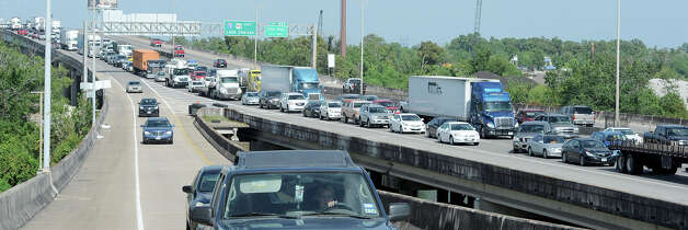 Traffic on Interstate 10 was backed up Monday due to a wreck that began on the east bound lanes near Pine Street. Several other accidents occurred causing both lanes to be closed. Photo taken Monday, July 30, 2012 Guiseppe Barranco/The Enterprise Photo: Guiseppe Barranco, STAFF PHOTOGRAPHER / The Beaumont Enterprise