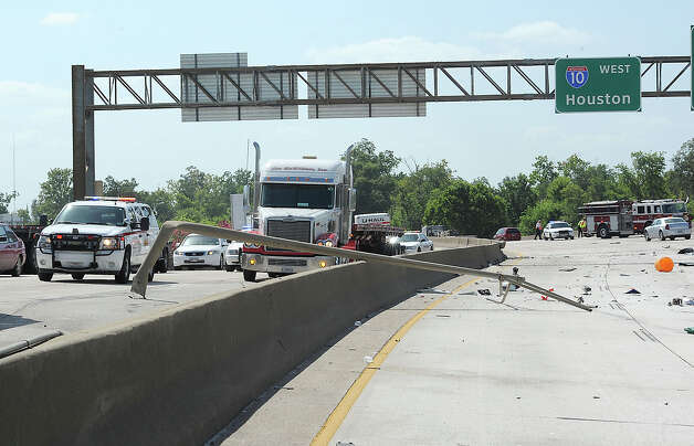 A light pole was struck and knocked onto the Interstate-10 divider during Monday's accident that closed down both lanes of traffic.  Photo taken Monday, July 30, 2012 Guiseppe Barranco/The Enterprise Photo: Guiseppe Barranco, STAFF PHOTOGRAPHER / The Beaumont Enterprise