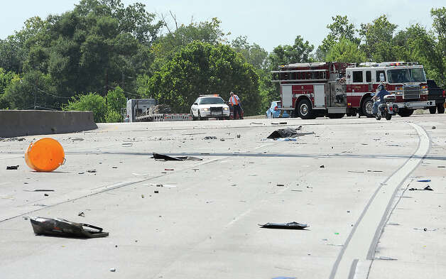 Debris littered Interstate 10 Monday after an accident that occurred near Pine Street. Photo taken Monday, July 30, 2012 Guiseppe Barranco/The Enterprise Photo: Guiseppe Barranco, STAFF PHOTOGRAPHER / The Beaumont Enterprise