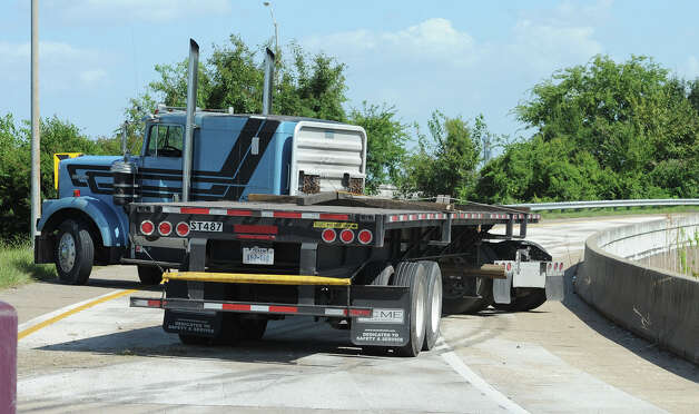 A jackknifed truck rests on the downtown exit ramp. Photo taken Monday, July 30, 2012 Guiseppe Barranco/The Enterprise Photo: Guiseppe Barranco, STAFF PHOTOGRAPHER / The Beaumont Enterprise