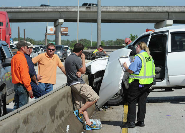 A truck was heavily damaged from an accident on Interstate 10 near Pine Street that shutdown both lanes of traffic.  Photo taken Monday, July 30, 2012 Guiseppe Barranco/The Enterprise Photo: Guiseppe Barranco, STAFF PHOTOGRAPHER / The Beaumont Enterprise