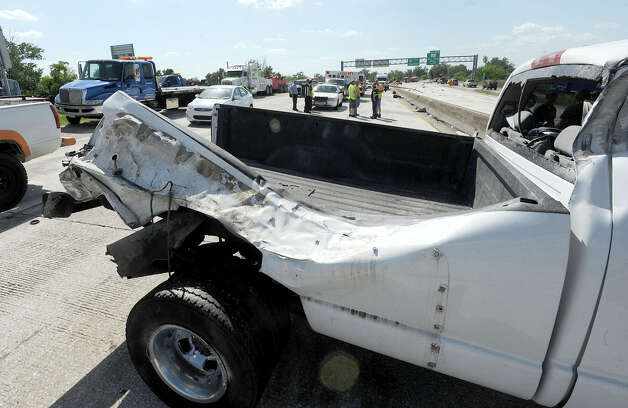 A heavy truck was heavily damaged from an accident on Interstate 10 near Pine Street that shutdown both lanes of traffic. Photo taken Monday, July 30, 2012 Guiseppe Barranco/The Enterprise Photo: Guiseppe Barranco, STAFF PHOTOGRAPHER / The Beaumont Enterprise