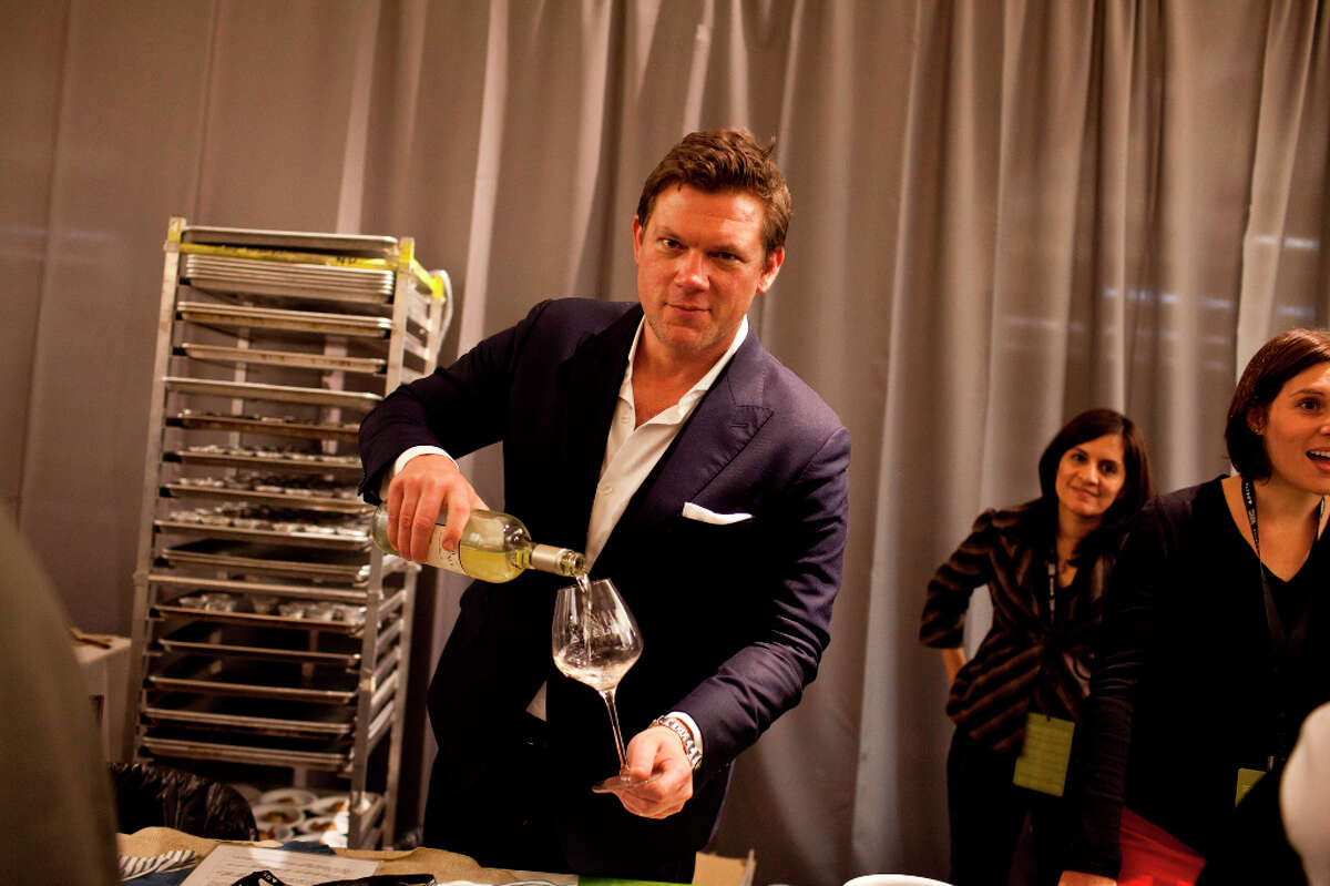 Tyler Florence pours wines at his booth during the Appellation Trail Tasting.