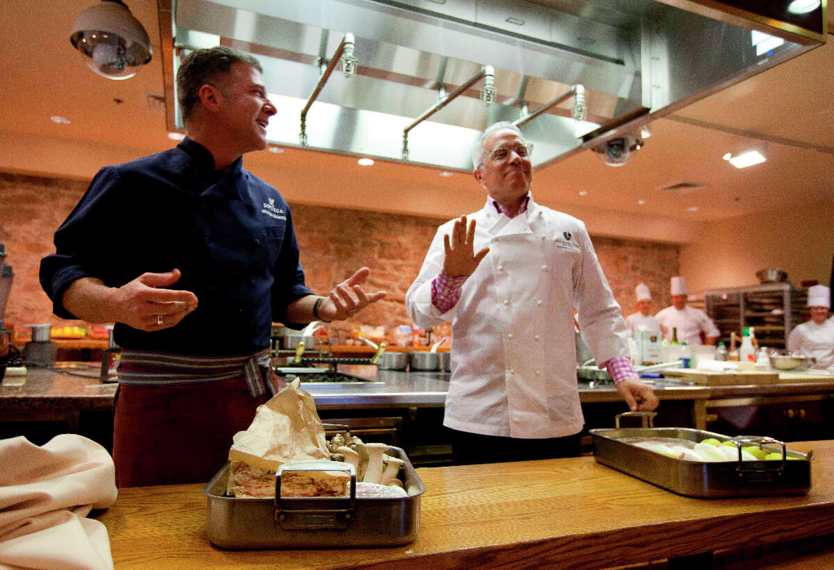 Chefs Michael Chiarello, left, and Geoffrey Zakarian, right, of New York City, joke with each other.
