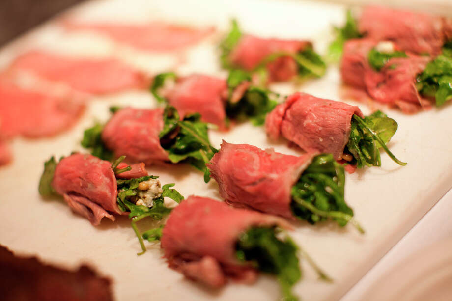 Local Five Dot Ranch carpaccio with Point Reyes Blue Cheese, wild arugula and truffle vinaigrette by chef Brian Whitmer of Vineleven during the Appellation Trail Tasting. Photo: Jason Henry, Special To The Chronicle / ONLINE_YES