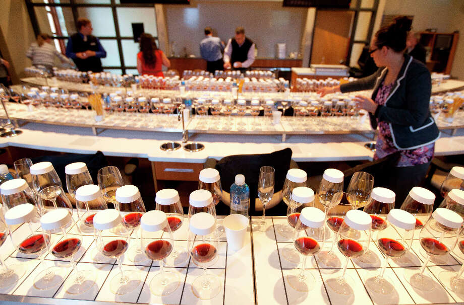 Teams of sommeliers fill and cover glasses. Photo: Eric Risberg, Associated Press / AP
