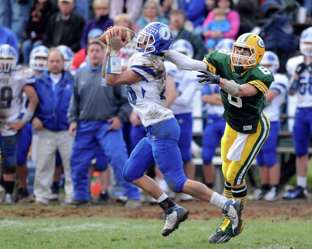Darien's Peter Gesualdi intercepts a ball intended for Trinity Catholic's Connor Amann during Saturday's football game at Trinity Catholic High School on November 10, 2012.