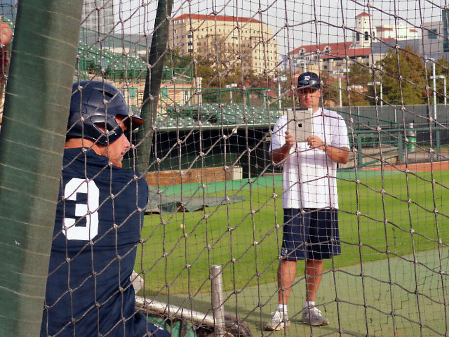 Volunteer assistant coach Lance Berkman videos freshman infielder/pitcher Connor Teykl during Monday's batting session at Reckling Park. (Joseph Duarte / Chronicle)