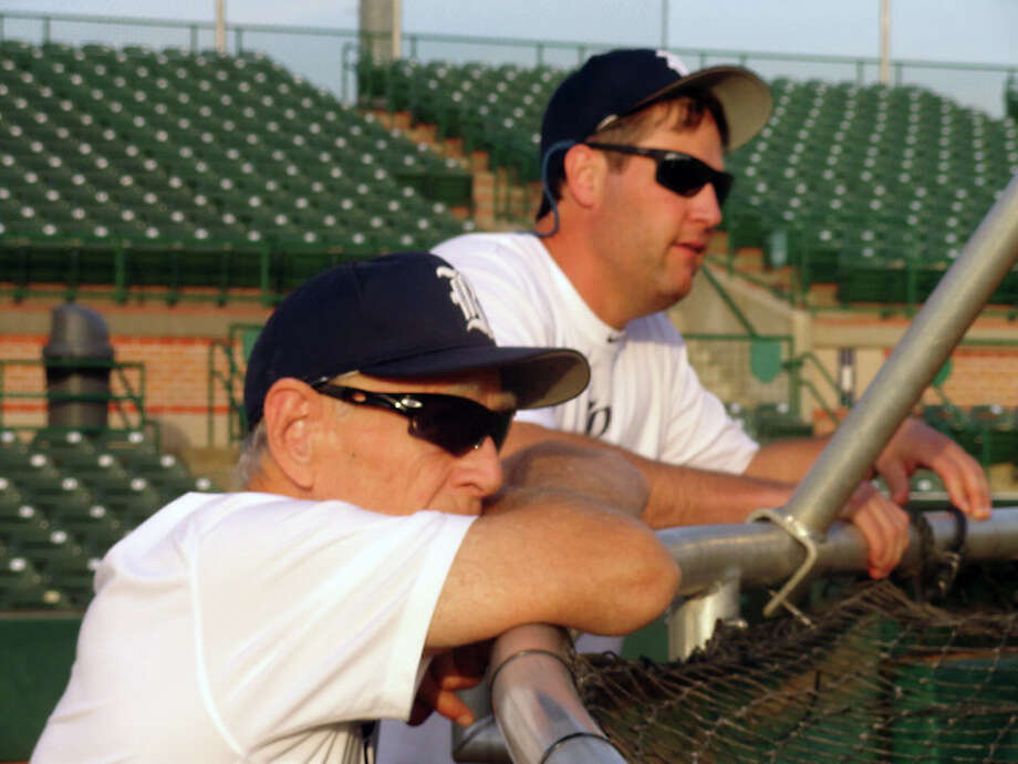Rice coach Wayne Graham and volunteer assistant coach Lance Berkman supervise a practice session. (Joseph Duarte / Chronicle)
