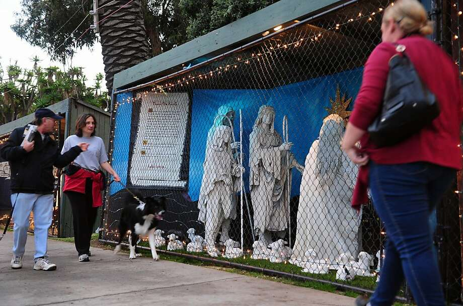 People walk past the traditional nativity display in Santa Monica's Palisades Park last December. Photo: Frederic J. Brown, AFP/Getty Images