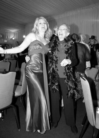 "Kristin Huffman and Louise Herz hit a high note at the ""Cabaret 2012"" benefit for At Home in Greenwich, which was held recently at the Hyatt Regency in Old Greenwich. Photo: ChiChi Ubiña\Contributed Photo, Contributed Photo / Greenwich Citizen"