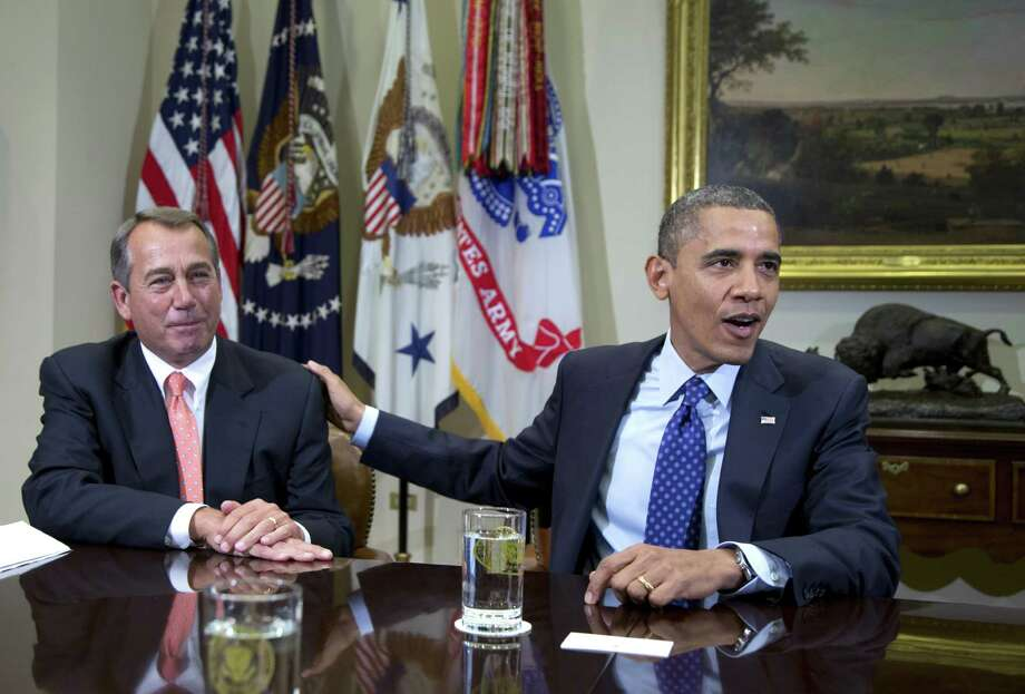 FILE -In this Friday, Nov. 16, 2012, file photo, President Barack Obama acknowledges House Speaker John Boehner of Ohio while speaking to reporters in the Roosevelt Room of the White House in Washington. U.S. stocks shook off their post-election slump Monday and recorded big gains as investors appeared more optimistic about a deal to avoid a federal budget crisis and were encouraged by a pair of corporate earnings reports. (AP Photo/Carolyn Kaster) Photo: Carolyn Kaster