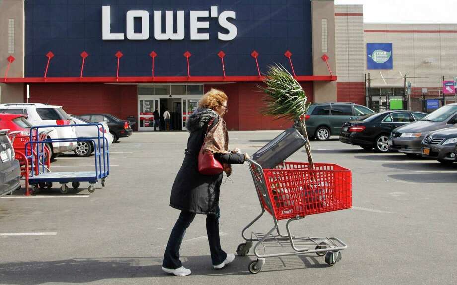 FILE - In this  Feb 21, 2012, file photo, a customer shops at Lowe's in New York. Lowe's said Monday, Nov. 19, 2012, its third-quarter net income surged 76 percent, helped by fewer charges and higher revenue. Its shares rose 5 percent in early premarket trading Monday. (AP Photo/Mark Lennihan, File) Photo: Mark Lennihan