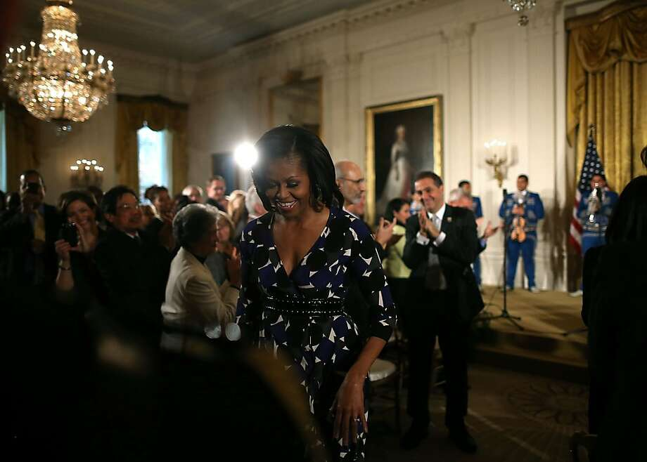 First lady Michelle Obama leaves the stage Monday at the White House after presenting awards to arts and humanities organizations benefiting underserved youth, including San Francisco's Digital Pathways Bay Area Video Coalition and Oakland's Youth Radio. Photo: Mark Wilson, Getty Images