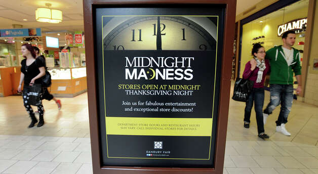 Signs at the Danbury Fair Mall tell shoppers at stores will be open at Midnight Thanksgiving night. Actually, some of the stores, like Sears, will open hours aerlier. Photo: Carol Kaliff / The News-Times